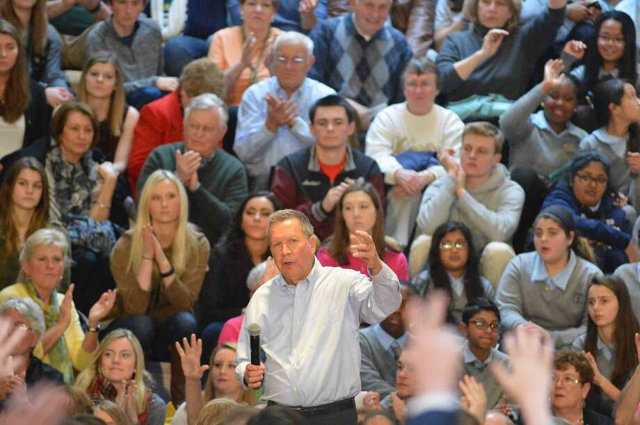 Hour Photo/Alex von Kleydorff Ohio Governor and Republican Presidential candidate John Kasich answers some questions from the audience during a Town Hall Metting at Sacred Heart University in Fairfield Conn. on Friday