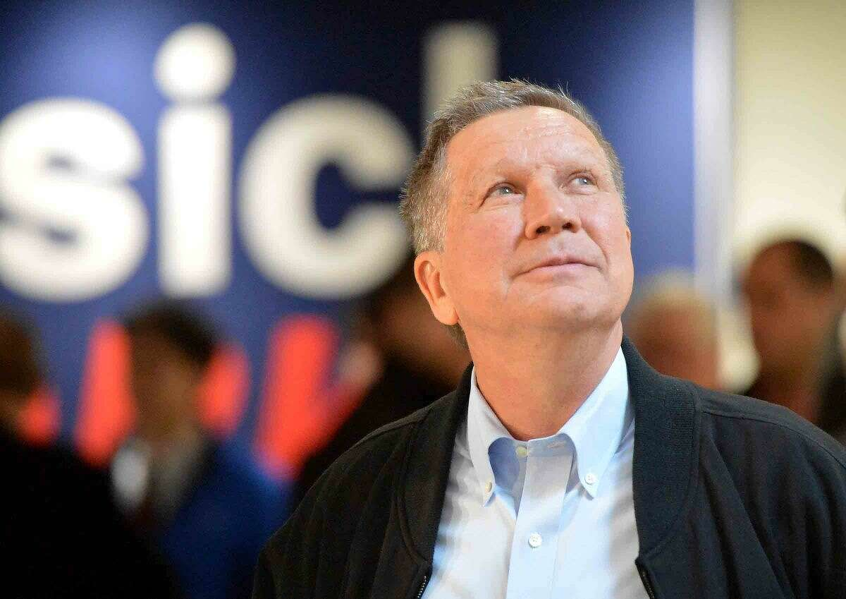 Hour Photo/Alex von Kleydorff Ohio Governor and Republican Presidential candidate John Kasich looks to the crowd gathered during a Town Hall Metting at Sacred Heart University, Martire Business and Communications Center in Fairfield Conn. on Friday
