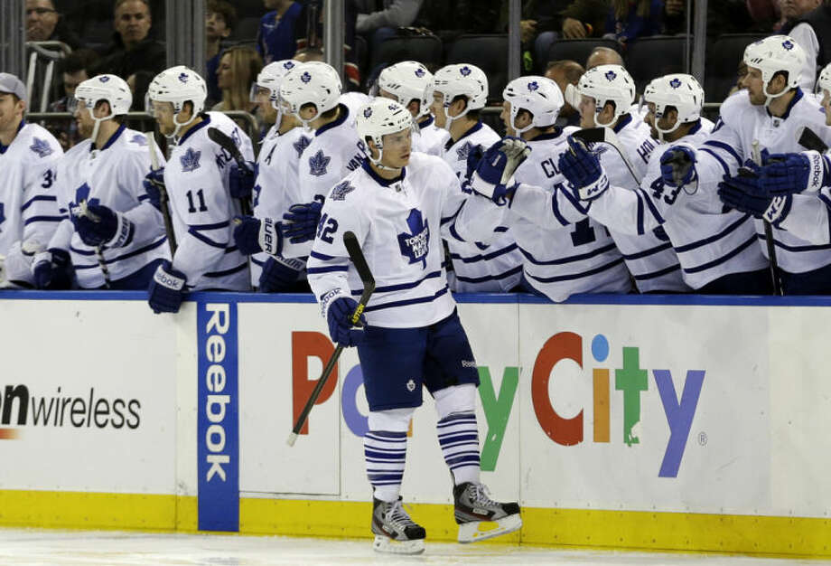 Toronto Maple Leafs' Tyler Bozak (42) celebrates with teammates after scoring on a penalty shot during the second period of an NHL hockey game against the New York Rangers on Wednesday, March 5, 2014, in New York. (AP Photo/Frank Franklin II)