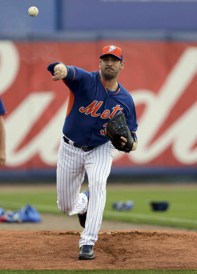 New York Mets starting pitcher Matt Harvey warms up before starting an exhibition spring training baseball game against the Detroit Tigers Friday, March 6, 2015, in Port St. Lucie, Fla. (AP Photo/Jeff Roberson)