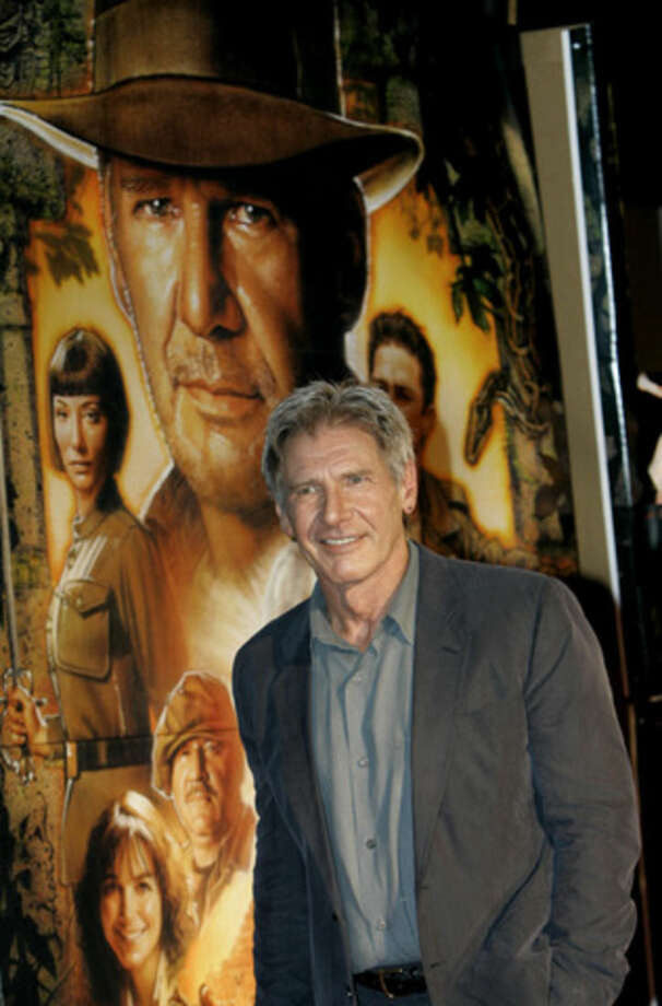 "FILE - In this June 5, 2008 file photo, actor Harrison Ford arrives for the premiere of his film ""Indiana Jones and the Kingdom of the Crystal Skull"" in Tokyo. Ford crash-landed his vintage airplane at a Los Angeles golf course Thursday, March 5, 2015, an official said. The 72-year-old ""Star Wars"" and ""Indiana Jones"" actor is an aviation enthusiast who often flies out of the Santa Monica Airport. He suffered moderate injuries and was taken to a hospital. (AP Photo/Shizuo Kambayashi, File)"