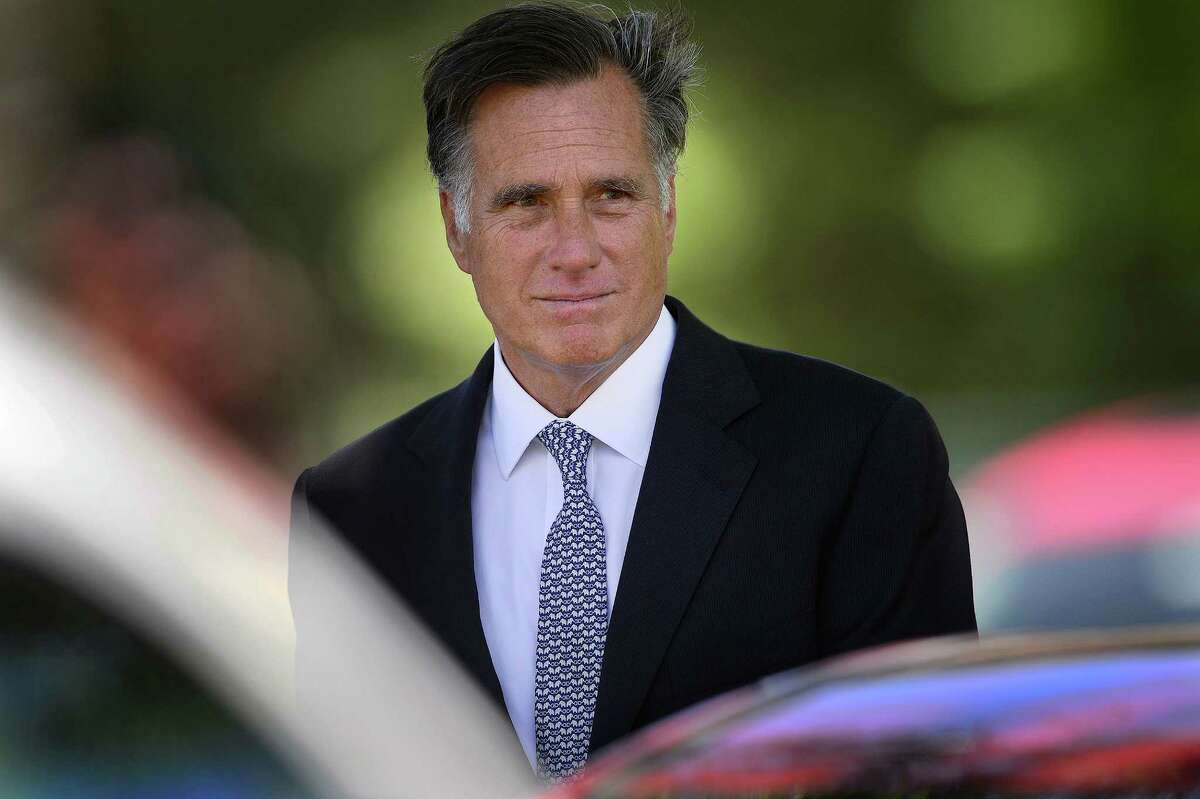 Mitt Romney says he fears Trump is appealing to the racist tendencies of some Americans.