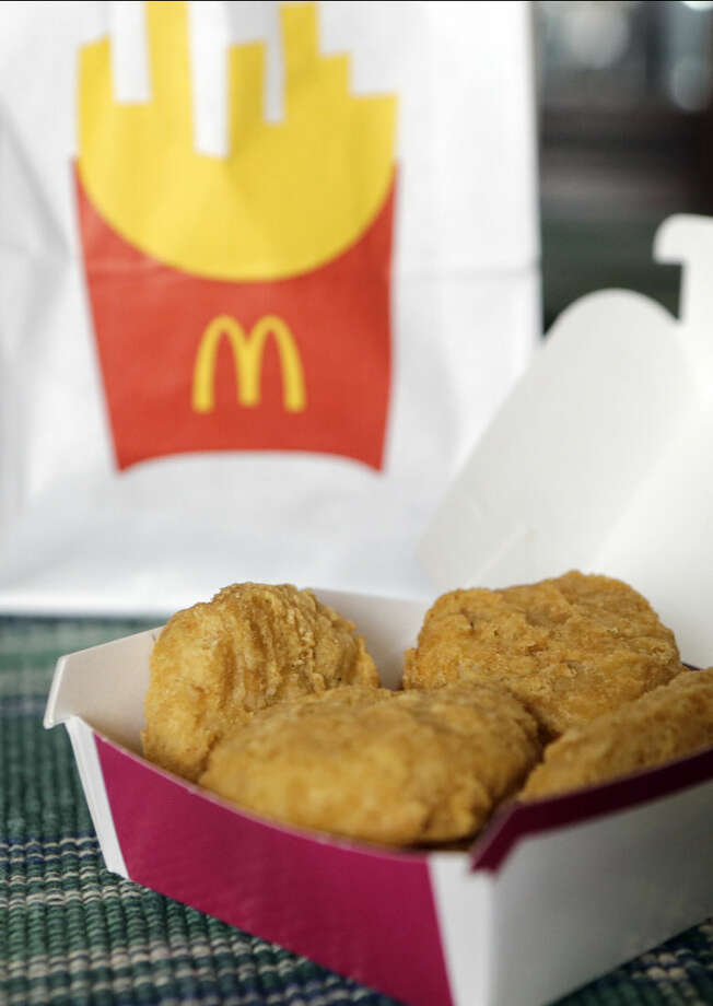An order of McDonald's Chicken McNuggets is displayed for a photo in Olmsted Falls, Ohio Wednesday, March 4, 2015. McDonald's says it plans to start using chicken raised without antibiotics important to human medicine and milk from cows that are not treated with the artificial growth hormone rbST. (AP Photo/Mark Duncan)