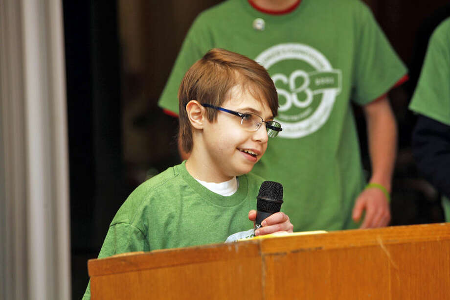 """Ryan Tucker, 11, speaks about fighting a brain tumor during the St. Baldrick's Foundation's """"Shaving the Way to Conquer Kid's Cancer"""" event at Wilton High School Wednesday evening."""