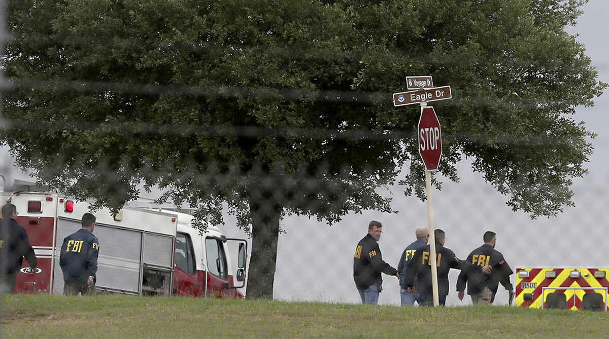 First responders and FBI agents gather near the scene of a shooting at Joint Base San Antonio-Lackland, Friday, April 8, 2016, in San Antonio. (John Davenport/The San Antonio Express-News via AP) RUMBO DE SAN ANTONIO OUT; NO SALES; MANDATORY CREDIT