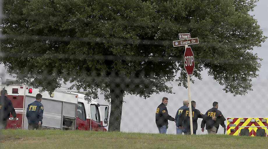 First responders and FBI agents gather near the scene of a shooting at Joint Base San Antonio-Lackland, Friday, April 8, 2016, in San Antonio. (John Davenport/The San Antonio Express-News via AP) RUMBO DE SAN ANTONIO OUT; NO SALES; MANDATORY CREDIT