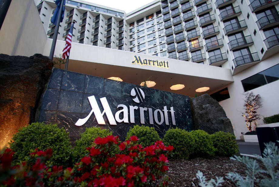FILE - This April 20, 2011 file photo shows Portland Marriott Downtown Waterfront in Portland, Ore. Marriott International has cleared one of its major hurdles on its journey to acquire rival Starwood and become the world's largest hotel chain. Shareholders in both Marriott and Starwood Hotels & Resorts Worldwide Inc. approved the $14.41 billion sale Friday, April 8, 2016. (AP Photo/Rick Bowmer)