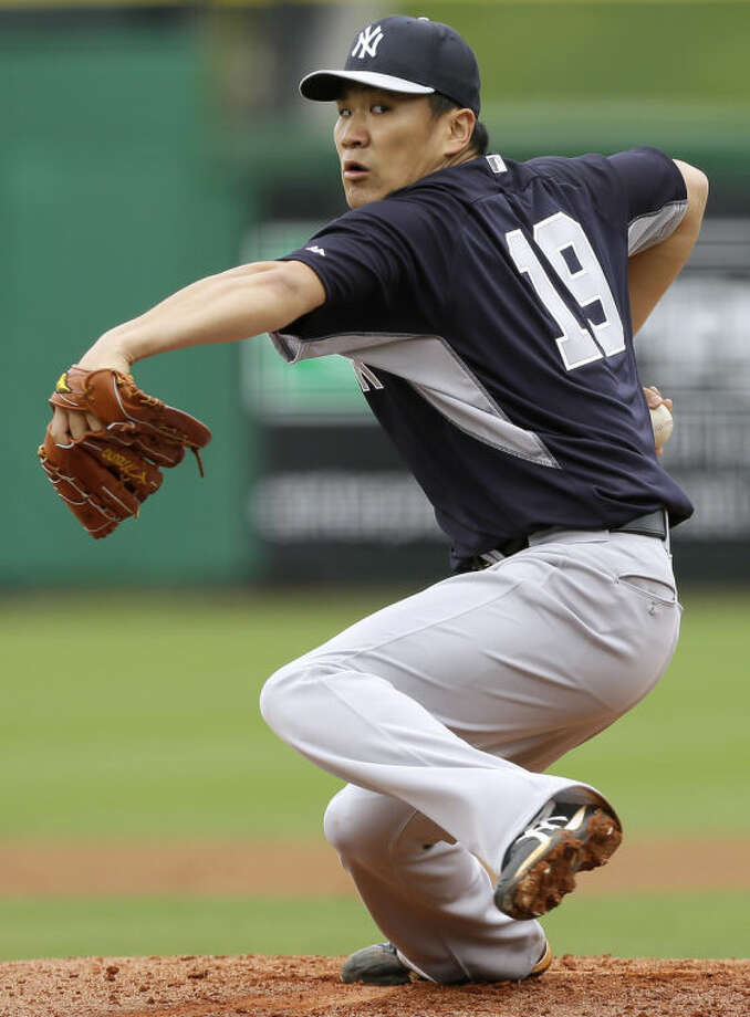 New York Yankees starting pitcher Masahiro Tanaka throws a pitch during the second inning of an exhibition baseball game against the Philadelphia Phillies Thursday, March 6, 2014, in Clearwater, Fla. (AP Photo/Charlie Neibergall)