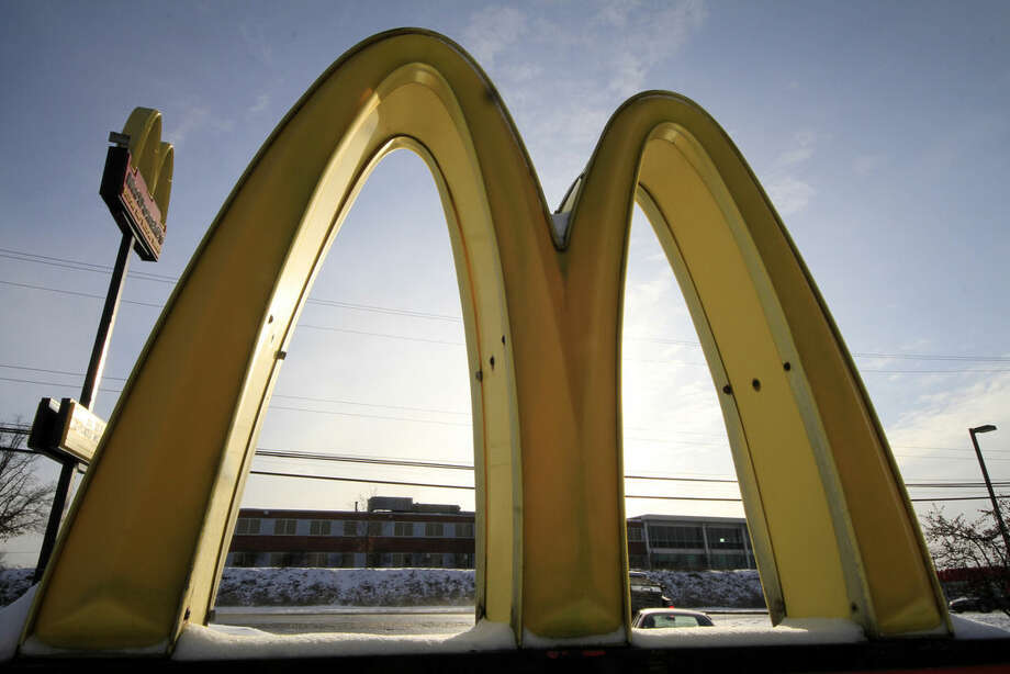 FILE - In this Tuesday, Jan. 21, 2014, file photo, the McDonald's Golden Arches logo at a McDonald's restaurant is covered with snow in Robinson Township, Pa. McDonald's on Wednesday, March 4, 2015 said it plans to start using chicken raised without antibiotics important to human medicine and milk from cows that are not treated with the artificial growth hormone rbST. (AP Photo/Gene J. Puskar, File)