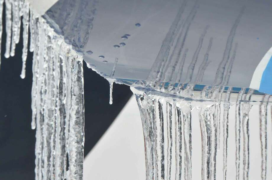 Hour Photo/Alex von Kleydorff Icicles form from the hull of a sailboat in winter storage during Thursday's snowstorm