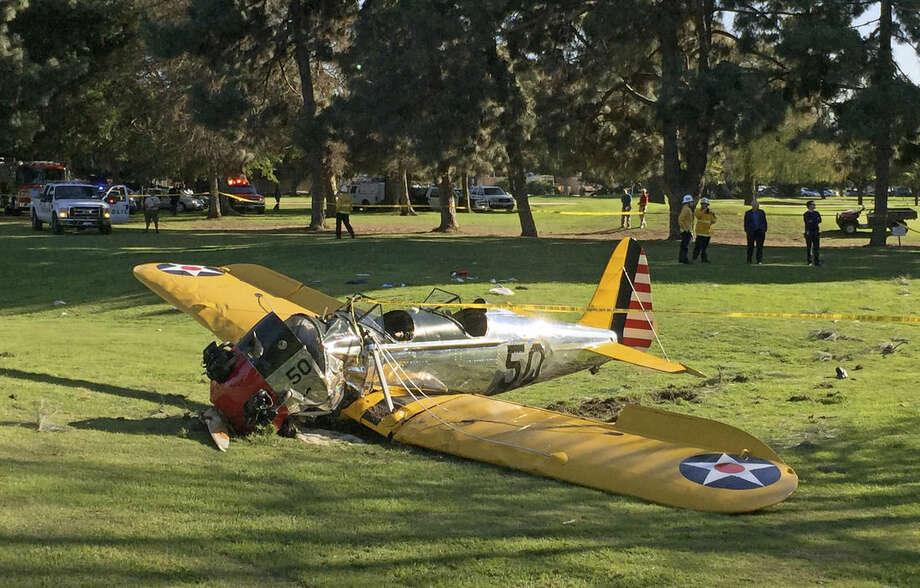 A small plane lies where it crash-landed on Penmar Golf Course in the Venice area of Los Angeles on Thursday, March 5, 2015. The course is near the Santa Monica, Calif. Municipal Airport, just west of a runway, but there was no immediate confirmation on whether the plane had taken off or was trying to land. (AP Photo/Damian Dovarganes)