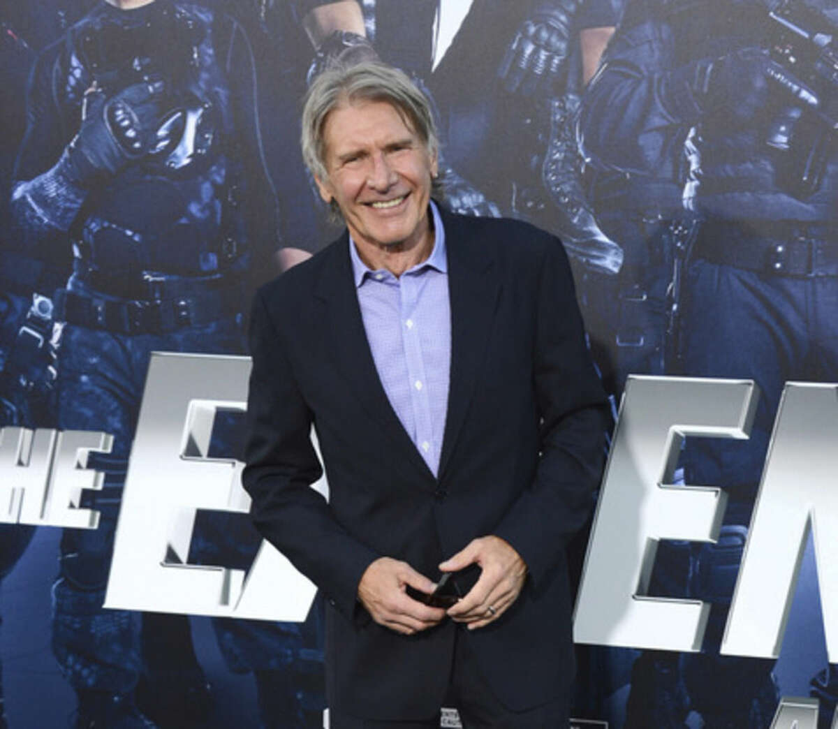"""FILE - In this Aug. 11, 2014 file photo, Harrison Ford arrives at the premiere of """"The Expendables 3"""" at TCL Chinese Theatre in Los Angeles. An official says Ford crash-landed his vintage airplane at a Los Angeles golf course. He suffered moderate injuries. Los Angeles fire officials say the single-engine plane went down at about 2:30 p.m. Thursday, March 5, 2015, on the green at Penmar Golf Course in the Venice area of Los Angeles. (Photo by Jordan Strauss/Invision/AP, File)"""