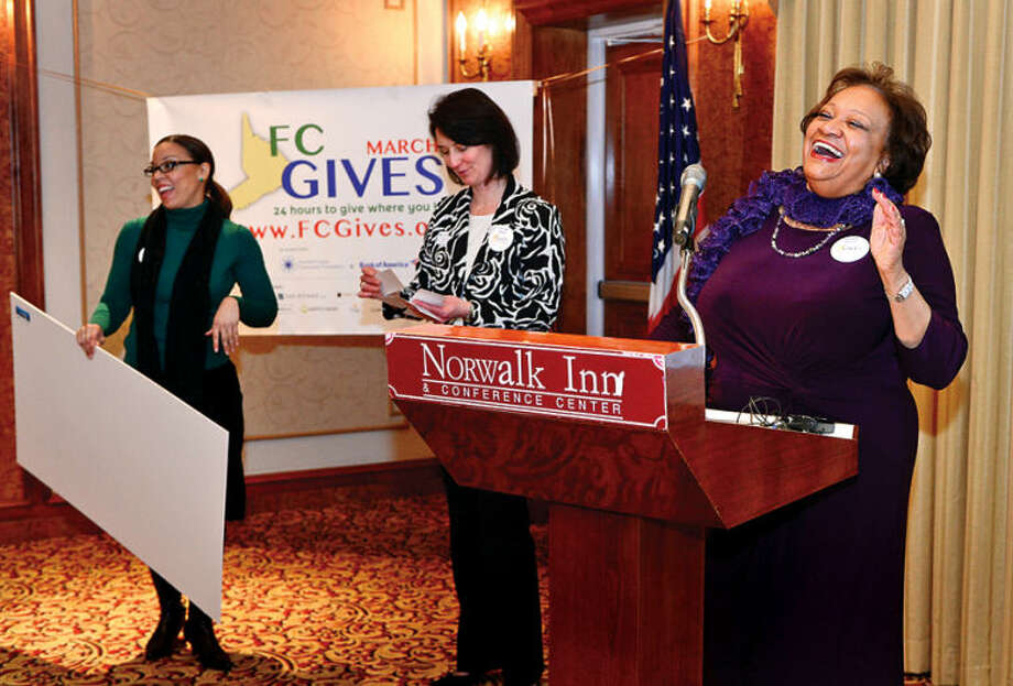 Hour photo / Erik Trautmann From right, Fairfield County Community Foundation President and CEO, Juanita James, Director of the Center for Non Profit Excellence, Elaine Mintz, and Juanita's assistant Alanna Morton share a laugh as during the launch of Fairfield County Giving Day at the Norwalk Inn Friday morning. Fairfield County Giving Day is an initiative to raise $1 million for up to 400 Fairfield County, Connecticut nonprofits in 24-hours.