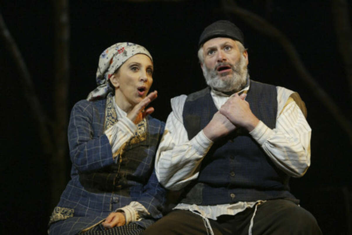 """FILE - This 2005 file photo provided by Barlow-Hartman shows, Andrea Martin, left, as Golde and Harvey Fierstein as Tevye in the revival of """"Fiddler on the Roof,'' at Broadway's Minskoff Theatre in New York. Producers Jeffrey Richards and Jerry Frankel said Thursday, March 6, 2014, that they will present a revival of ?""""Fiddler on the Roof,?"""" one of the last great musicals of Broadway's Golden Age, on Broadway in the fall of 2015. (AP Photo/Carol Rosegg, file)"""