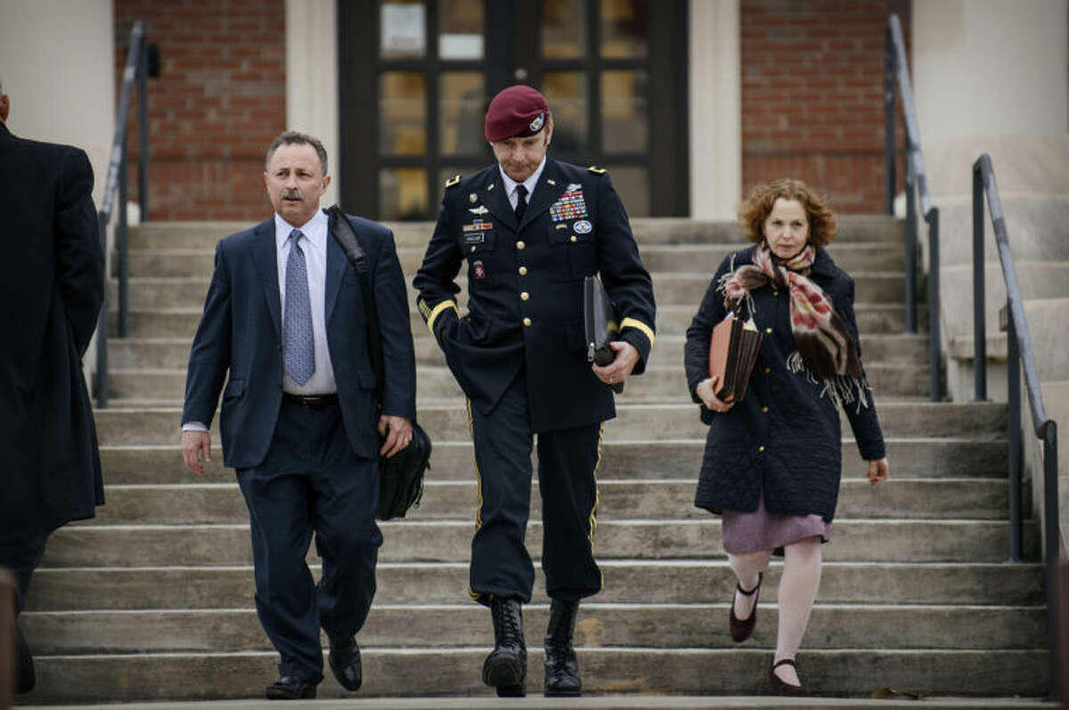 FILE - In this March 4, 2014 file photo, Brig. Gen. Jeffrey Sinclair leaves the courthouse with his lawyers Richard Scheff, left, and Ellen C. Brotman, following a day of motions at Fort Bragg, N.C. Less than a month before Sinclair's trial on sexual assault charges, the lead prosecutor broke down in tears Tuesday as he told a superior he believed the primary accuser in the case had lied under oath. (AP Photo/The Fayetteville Observer, James Robinson) MANDATORY CREDIT