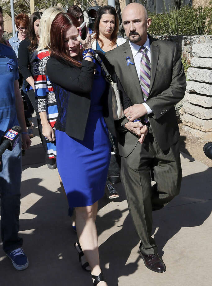 Tanisha Sorenson, sister of murder victim Travis Alexander, cries as she leaves the court house with family and friends, Thursday, March 5, 2015, in Phoenix. A judge declared a mistrial Thursday in the Jodi Arias sentencing retrial after a jury deadlocked on whether the convicted murderer should be executed or sent to prison for life for the 2008 killing of Travis Alexander.(AP Photo/Matt York)