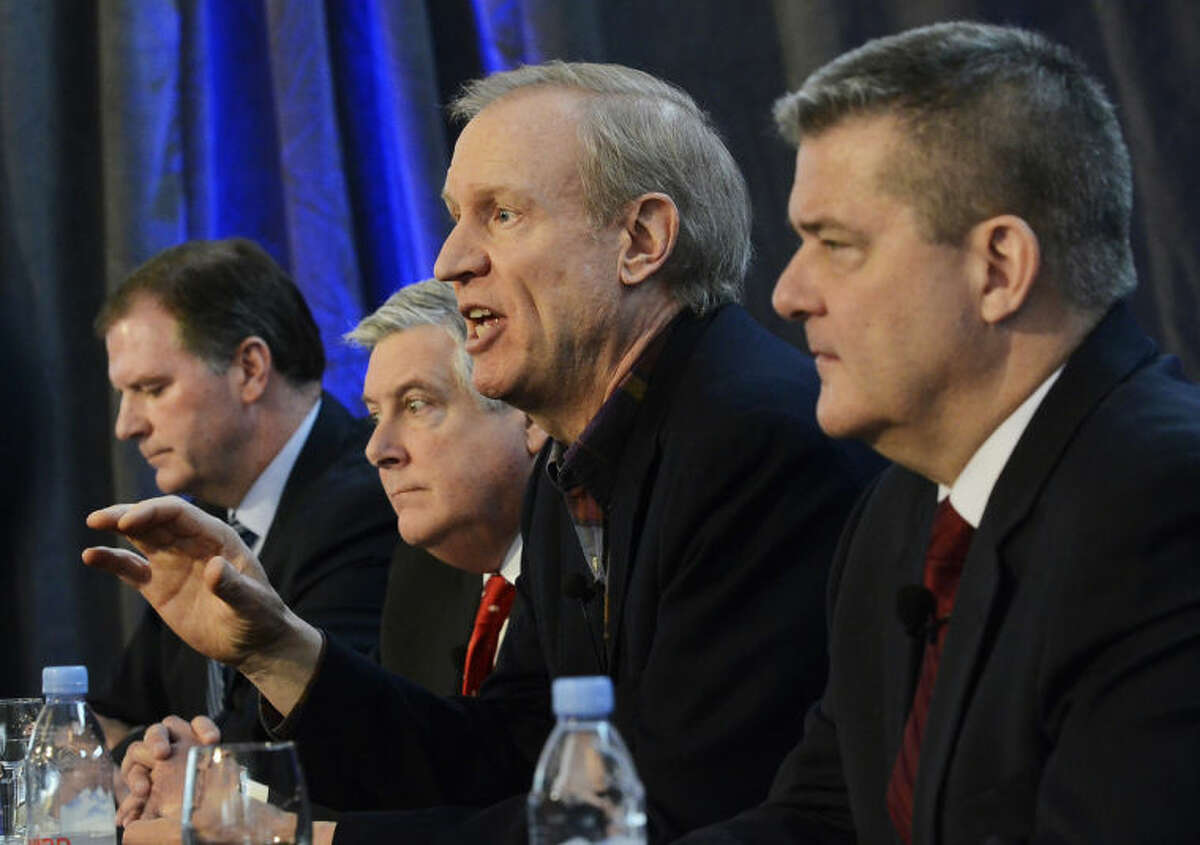 FILE - In this Jan. 16, 2014 file photo, venture capitalist Bruce Rauner, second from right, a candidate for the Republican nomination for Illinois governor, speaks at a business forum in Mount Prospect, Ill., as his three challengers state Sens. Bill Brady, left, state Sen. Kirk Dillard, and state Treasurer Dan Rutherford, right , look on in Mount Prospect, Ill. It was the first time all four candidates appeared on a stage together in 2014. Rauner is considered the heavy favorite in the four-way GOP primary. (AP Photo/Daily Herald, Bob Chwedyk, File)