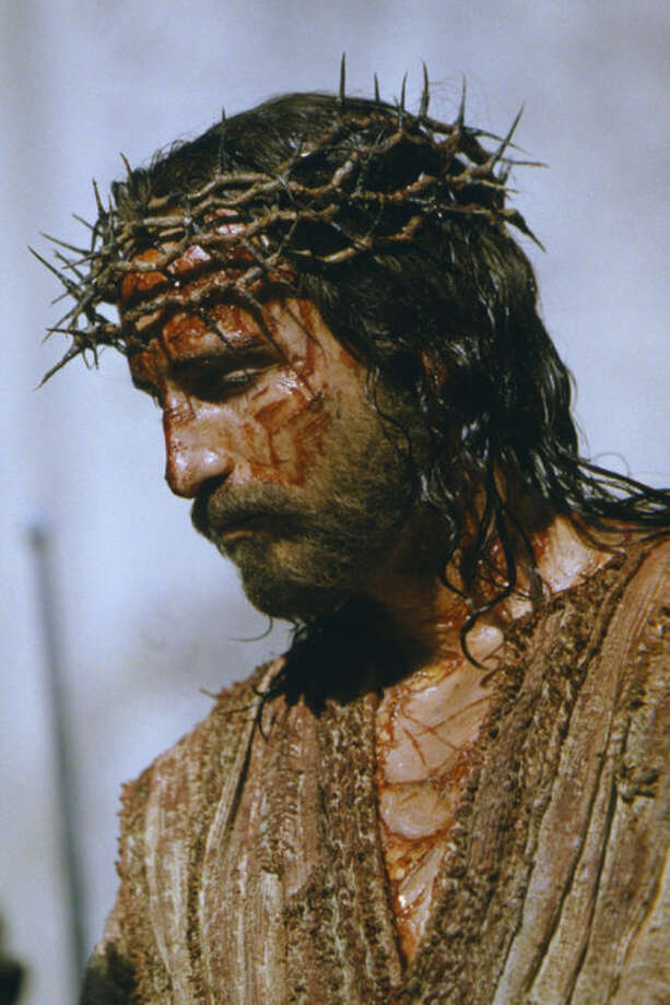 "FILE - This 2003 file photo released by Marquis Films shows Jim Caviezel, portraying Jesus Christ on the set of ""The Passion of the Christ."" (AP Photo/Philippe Antonello, Marquis Films Ltd.)"