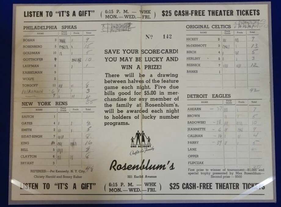 "In this Feb. 19, 2014 photo, a Rosenblum tournament scorecard showing information for games between the Philladelphia Sphas vs. the Harlem Rens, and the Original Celtics vs. the Detroit Eagles is show as part of an exhibit entitled ""The Black Fives,"" at the New-York Historical Society in New York. Dozens of teams flourished between 1904 and 1950 in what became known as the Black Fives Era, an often-overlooked piece of black history that is the subject of an exhibition opening at the New-York Historical Society on March 14. (AP Photo/Frank Franklin II)"