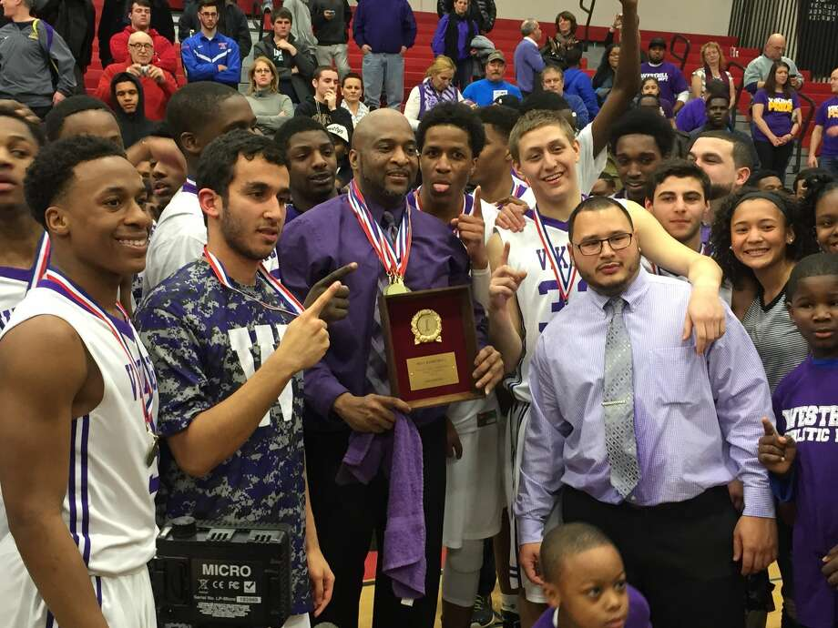 The Westhill Vikings took home the 2014-15 FCIAC boys basketball title with a 64-60 win over Norwalk. (Pete Paguaga/Hour photo)