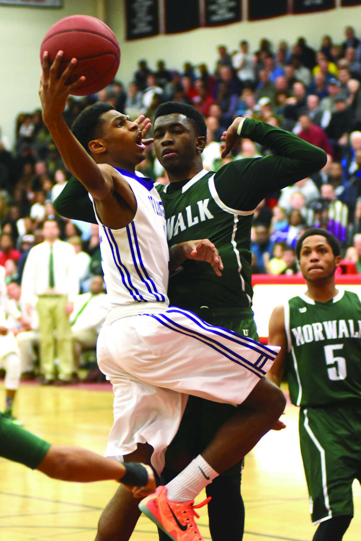 Westhill's Jeremiah Livingston goes up for a layup. Livingston scored a game high 40 points the Vikings' 64-60 win over Norwalk. (John Nash/Hour photo)