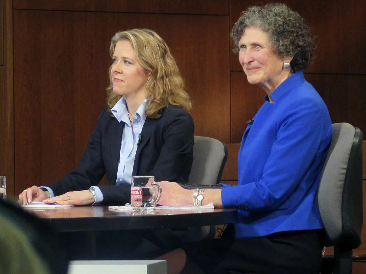 File - In this March 15, 2016, file photo, Wisconsin Supreme Court Justice Rebecca Bradley, left, and opponent JoAnne Kloppenburg listen during a debate at Marquette University in Milwaukee. While the U.S. Supreme Court vacancy has been a heated political topic nationally, quieter but equally partisan battles are being waged for control of state courts around the country. On Tuesday, April 5, 2016, Wisconsin voters head to the polls to decide a seat on that state's highest court amid a steady stream of TV ads. (AP Photo/Greg Moore, File)