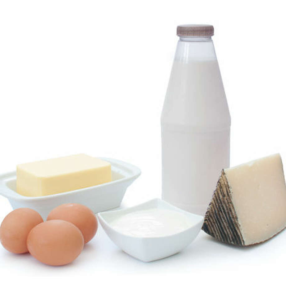 Dairy products and eggs over a white background