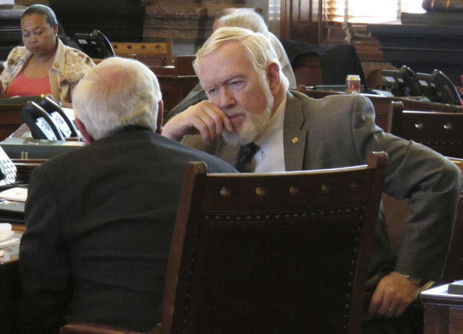 "File - In this March 21, 2016 photo, Kansas state Sen. Steve Fitzgerald, right, R-Leavenworth, confers with Sen. Rick Wilborn, R-McPherson, during a debate on a bill declaring that state Supreme Court justices can be impeached for attempting to ""usurp the power"" of lawmakers and the executive branch, at the Statehouse in Topeka, Kan. Lawmakers in Kansas and Missouri have proposed expanding rules for impeaching judges. (AP Photo/John Hanna)"