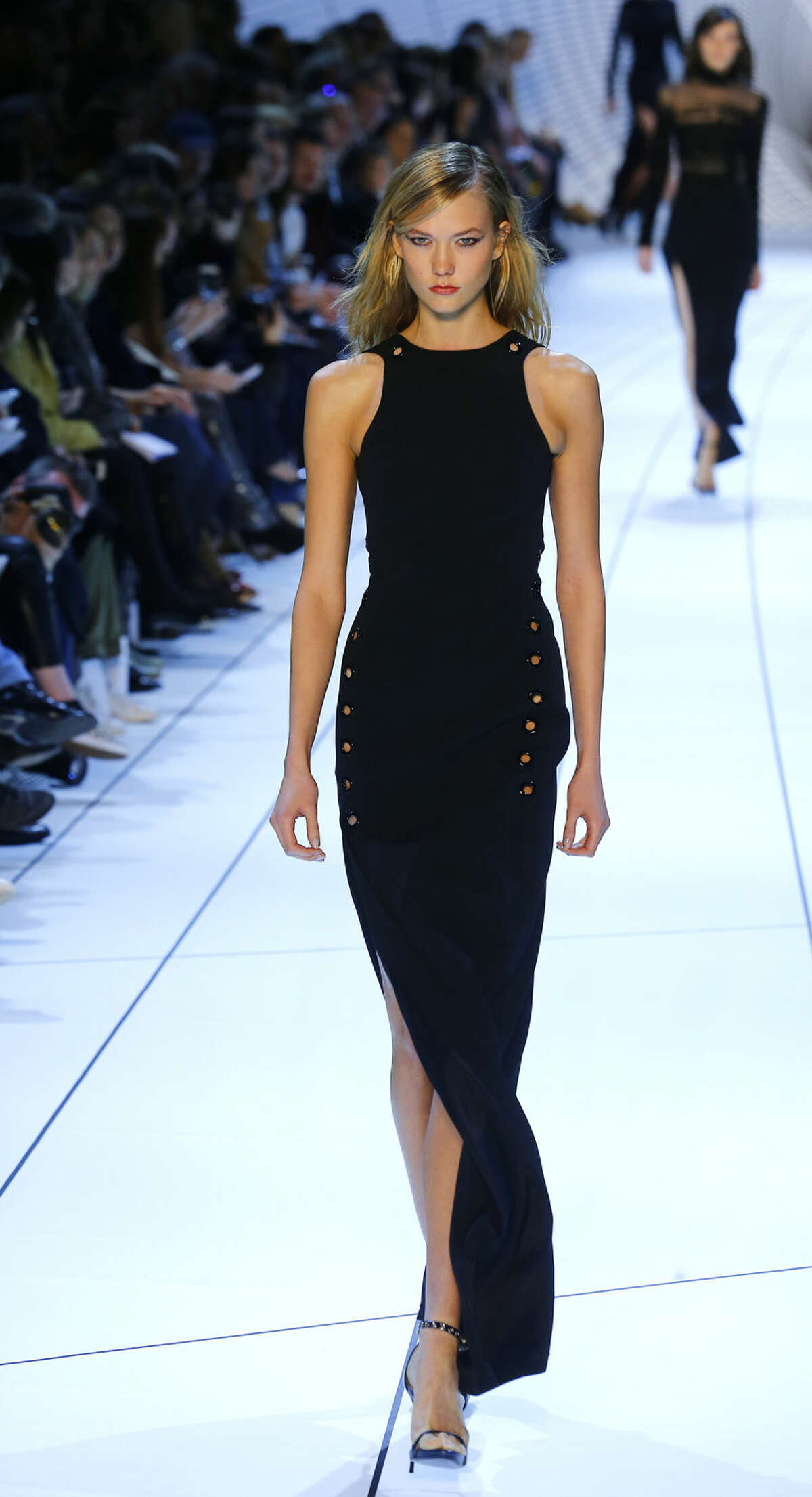 Model Karlie Kloss wears a creation for Mugler's ready to wear fall-winter 2015-2016 fashion collection during Paris fashion week, Saturday, March 7, 2015, Paris, France (AP Photo/Jacques Brinon)