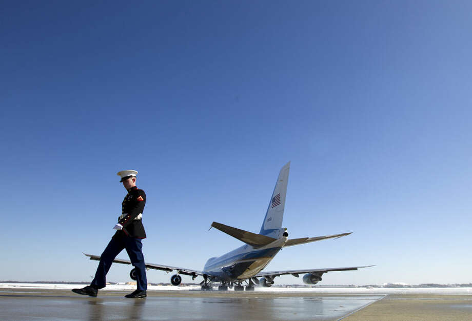 Marine Lance Cpl. Matt Clapp walks on the runway as Air Force One, with President Barack Obama aboard, departs from Andrews Air Force Base, Md., Friday, March 6, 2015, en route to Columbia, S.C., where he will participated in a town-hall meeting about the importance of community involvement. (AP Photo/Jose Luis Magana)