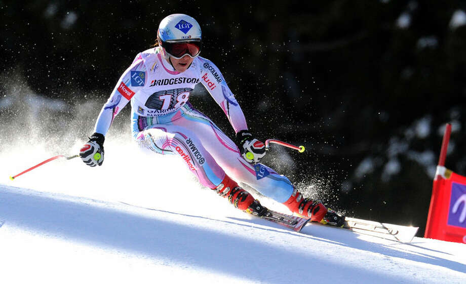 Tina Weirather of Liechtenstein competes on her way to win an alpine ski, women's World Cup downhill, in Garmisch Partenkirchen, Germany, Saturday, March 7, 2015. (AP Photo/Pier Marco Tacca)