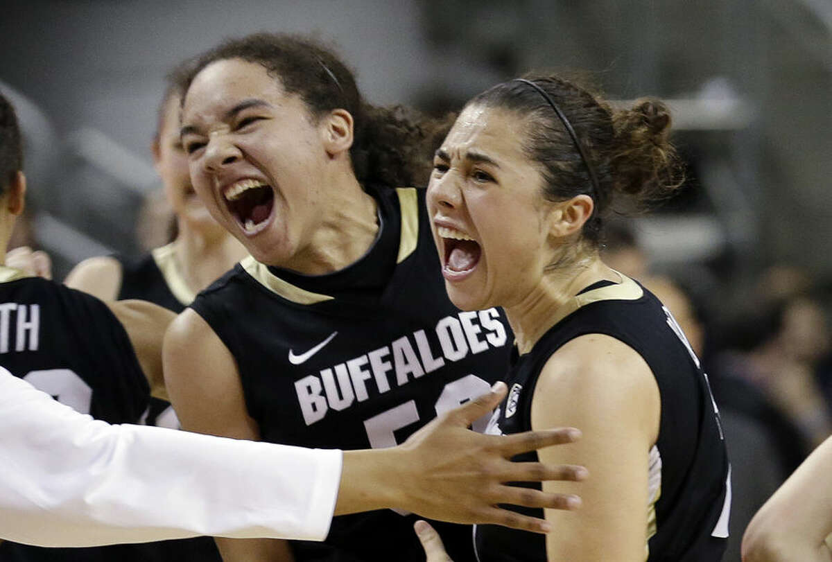 Colorado's Jamee Swan, left, and Jasmine Sborov celebrate after Colorado defeated Oregon State 68-65 in an NCAA college basketball game in the quarterfinals of the Pac-12 Conference tournament Friday, March 6, 2015, in Seattle. (AP Photo/Elaine Thompson)