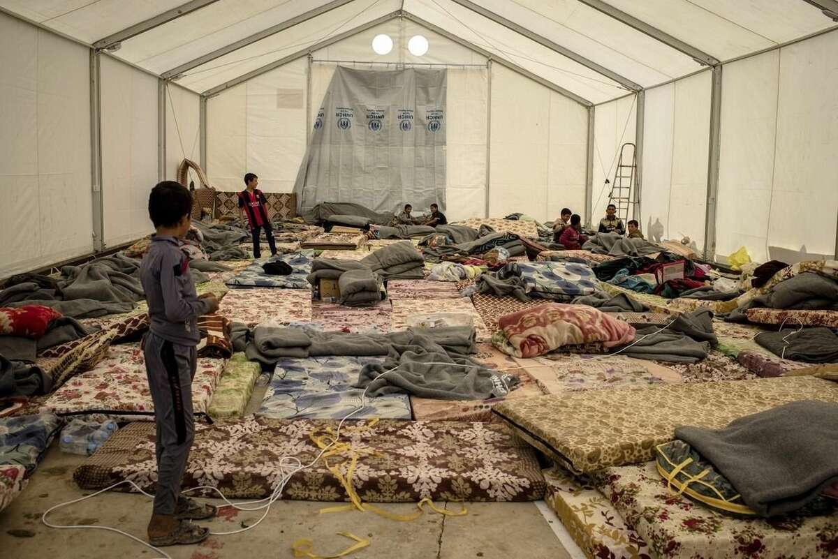 In this Tuesday, March 29, 2016 photo, children play in a tent at a holding center for newly displaced persons in Mahkmour, Iraq. Fighting between Iraqi forces and militants affiliated with the Islamic State group close to Iraq's second largest city, has displaced over 2,000 people in the past week. The families arriving in the Kurdish-held town of Makhmour are finding safety, but their future remains uncertain. (AP Photo/Cengiz Yar)