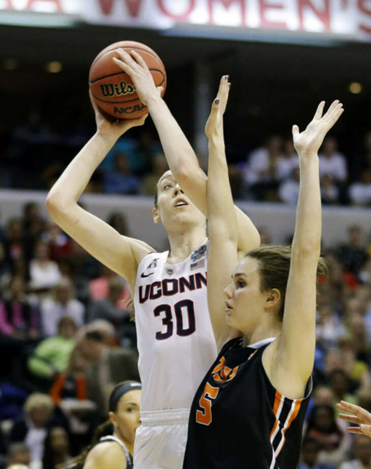 Connecticut's Breanna Stewart (30) shoots against Oregon State's Samantha Siegner (5) during the first half of a national semifinal game at the women's Final Four in the NCAA college basketball tournament Sunday, April 3, 2016, in Indianapolis. (AP Photo/Michael Conroy)