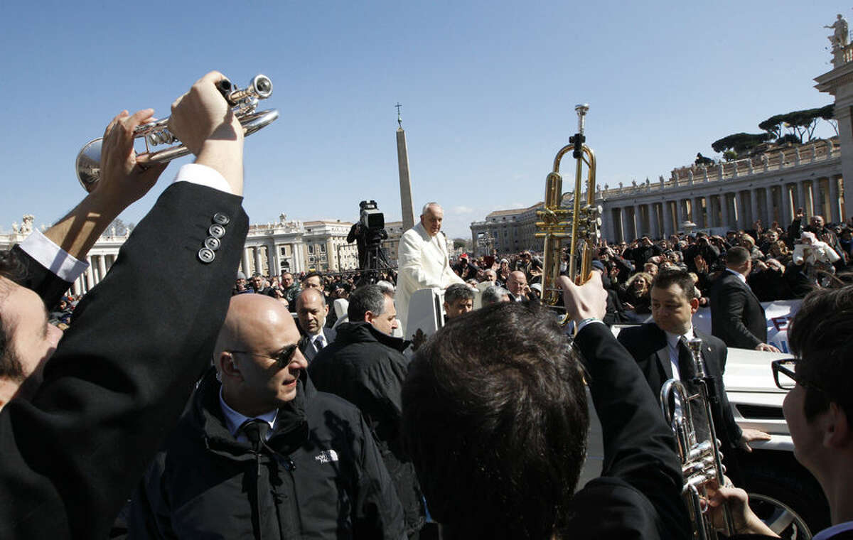 """Musicians greet Pope Francis as he leaves after meeting members of CL, """"Communion and Liberation"""" movement in St. Peter's Square at the Vatican, Saturday, March 7, 2015. (AP Photo/Riccardo De Luca)"""