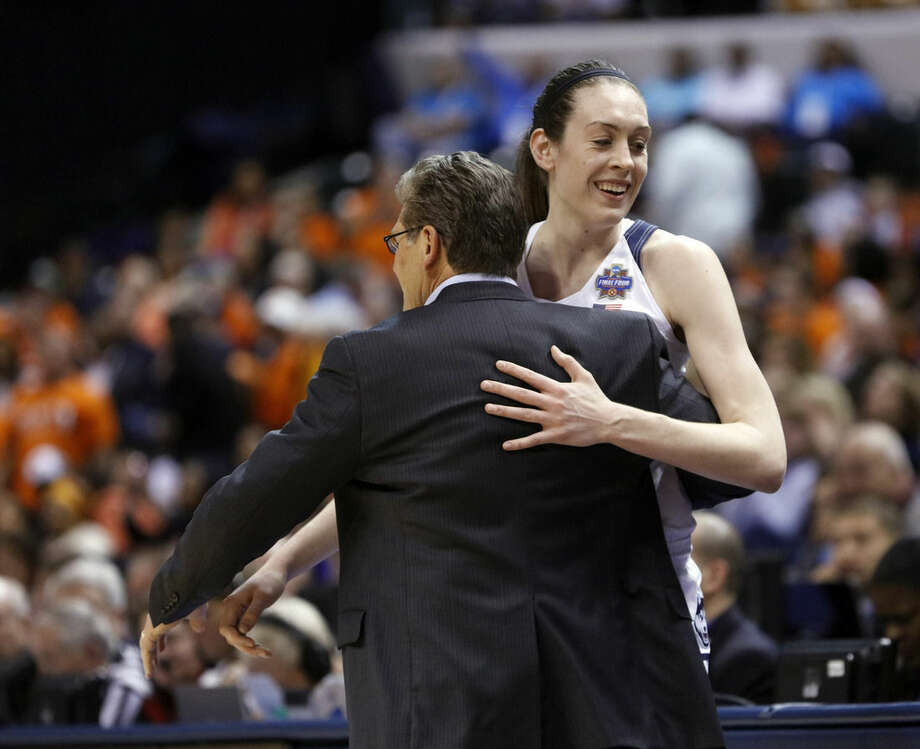 Connecticut's Breanna Stewart (30) is greeted by head coach Geno Auriemma as she is taken out of the game during the second half of a national semifinal game against Oregon State, at the women's Final Four in the NCAA college basketball tournament Sunday, April 3, 2016, in Indianapolis. Connecticut won 80-51. (AP Photo/AJ Mast)