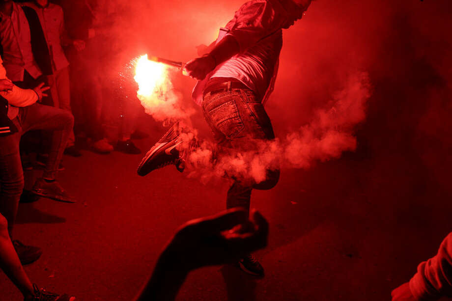 "In this Thursday, March 5, 2015 photo, a young man dances with flares during a local wedding in Salam City, a suburb on the outskirts of Cairo. Since the 2011 uprising, the music of ""Mahraganat,"" Arabic for ""festivals,"" has emerged from and spread through impoverished communities, where local musicians play, especially during weddings, their auto-tuned beats and songs that tackle social, political and cultural issues. (AP Photo/Mosa'ab Elshamy)"
