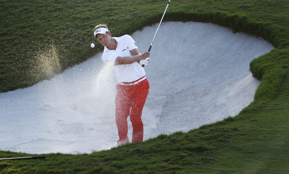 Luke Donald, of England, chips onto the 18th green during the second round of the Cadillac Championship golf tournament in Doral, Fla., Friday, March 6, 2015. (AP Photo/J Pat Carter)