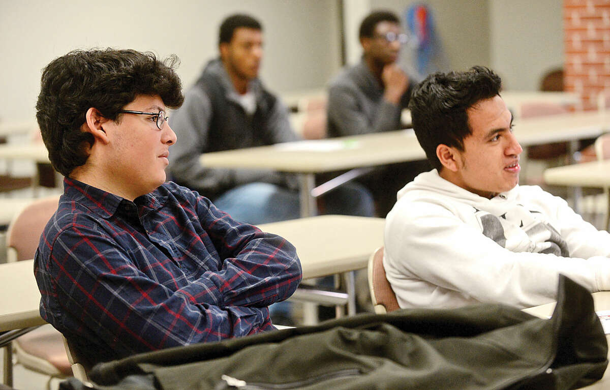 """Norwalk Community College (NCC) students listen to Charlotte Poth and Ellie MacGregor of The Center for Sexual Assault Crisis Counseling and Education as they lead a sexual assault prevention workshop for young men, """"Where Do You Stand?,"""" at NCC Tuesday."""