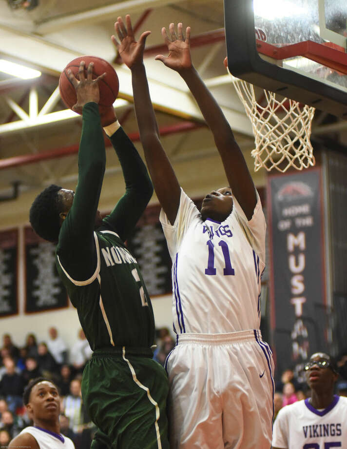 Hour photo/John Nash - Action from the FCIAC Boys Basketball championship game between Norwalk and Westhill. Westhill won the game, 64-60.