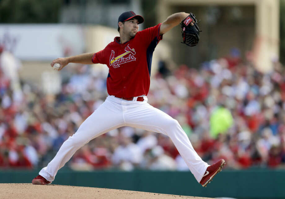 St. Louis Cardinals starting pitcher Michael Wacha throws during the first inning of an exhibition spring training baseball game against the New York Mets on Sunday, March 2, 2014, in Jupiter, Fla. (AP Photo/Jeff Roberson)