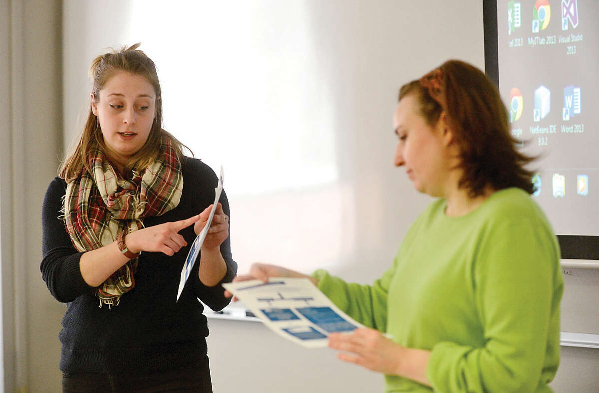 """Ellie MacGregor and Charlotte Poth of The Center for Sexual Assault Crisis Counseling and Education lead a sexual assault prevention workshop for young men, """"Where Do You Stand?"""", at Norwalk Community College Tuesday."""