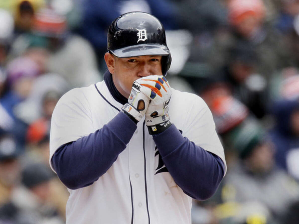 Detroit Tigers' Miguel Cabrera tries to keep his hands warm while batting against the New York Yankees during the fourth inning of a baseball game Saturday, April 9, 2016, in Detroit. (AP Photo/Duane Burleson)