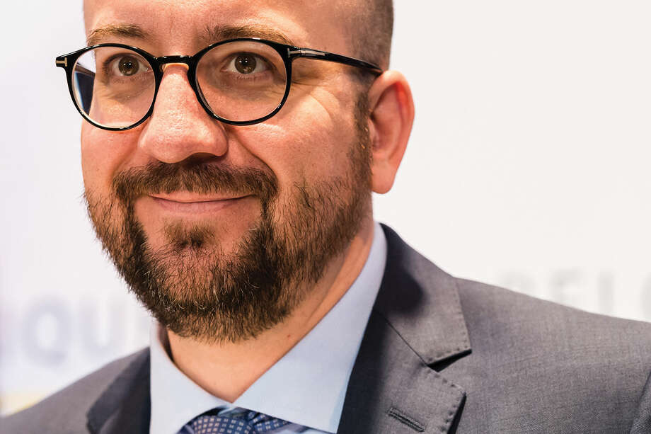 Belgium's Prime Minister Charles Michel addresses the media on the structural reforms in Brussels on Saturday, April 9, 2016. The arrest Friday of six men suspected of links to the Brussels bombings, including the last known fugitive in last year's Paris attacks, raised new questions about the extent of the Islamic State cell believed to have carried out the intertwined attacks that left 162 people dead in two countries. (AP Photo/Geert Vanden Wijngaert)