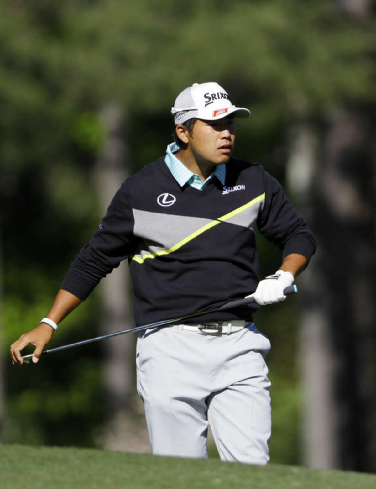 Hideki Matsuyama, of Japan, watches his tee shot on the 12th hole during the third round of the Masters golf tournament Saturday, April 9, 2016, in Augusta, Ga. (AP Photo/David J. Phillip)