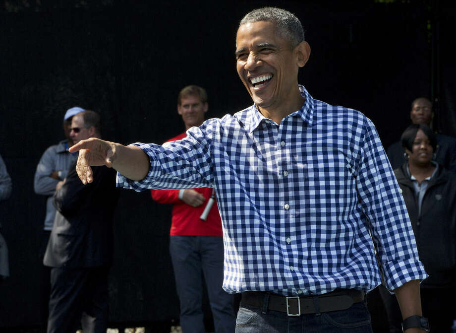 FILE - In this March 28, 2016, file photo, President Barack Obama reacts while playing tennis during the White House Easter Egg Roll at the White House in Washington. Americans' ratings of Obama are creeping up. More than half of Americans, 53 percent, have a favorable opinion and 44 percent have an unfavorable opinion of the president, according to a new Associated Press-GfK poll. That's an improvement since February, when 45 percent said they rated him favorably. (AP Photo/Jacquelyn Martin, File)