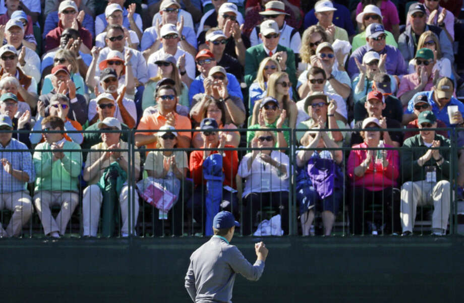 Jordan Spieth holds up his ball to the gallery after a birdie on the eighth hole during the third round of the Masters golf tournament Saturday, April 9, 2016, in Augusta, Ga. (AP Photo/Chris Carlson)