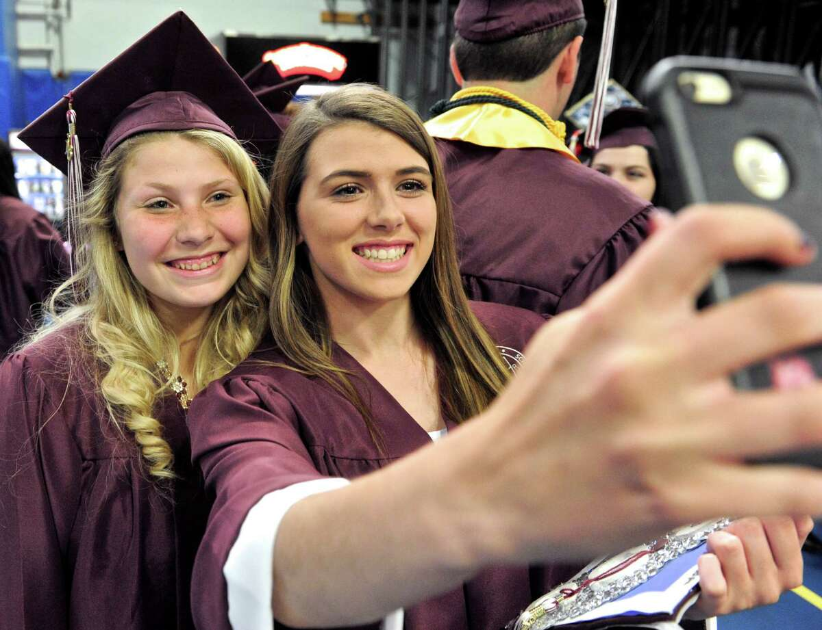 Sarah Elizabeth Cardillo, left, and Megan Jeanette Fuller take a selfie before the start of the 2016 Bethel High School Commencement Ceremony, held on Friday, June 10, 2016, at the O'Neil Center at Western Connecticut State University, Danbury, Conn.