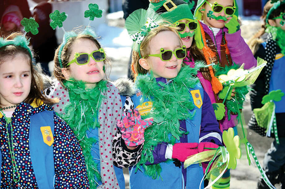 Hour photo / Erik Trautmann Stamford St Patrick's Day Parade participants and local residents including brownies from troop 50012 enjoy the sunny Saturday afternoon as the procession proceeds down Bedford St.