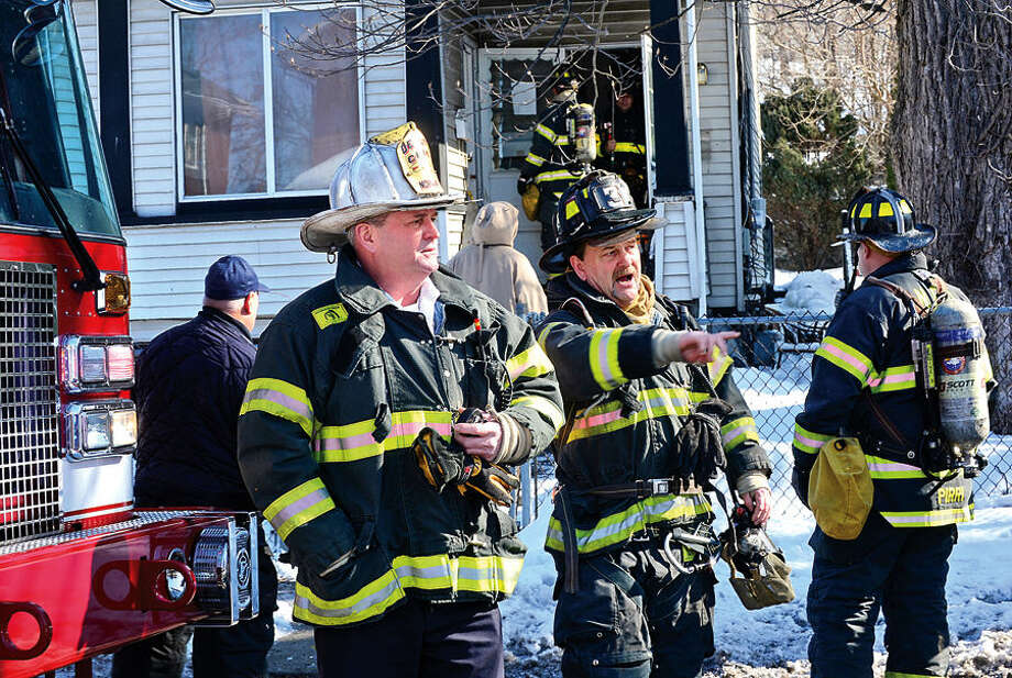 Hour photo / Erik Trautmann Norwalk Fire Department personnel respond to a fire call at 114 Woodward Ave Saturday morning where a pipe burst realeasing steam into the apartments.